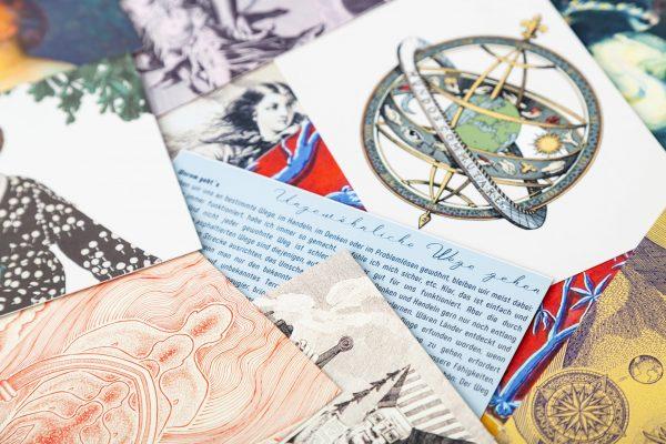 Überblick einzelner WeltenWandler Karten mit unterschiedlichen Motiven und anleitenden Texten.